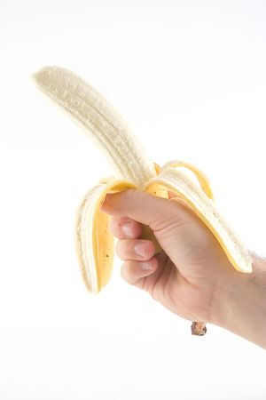 Hand holding a banana photo