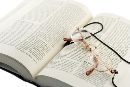 Open book and glasses photo