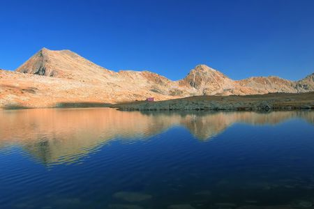 Mountain range with its reflection in the nearby glacial lake in Bulgaria Stock Photo - 437554