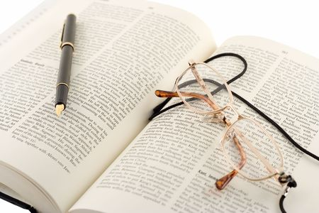 Open book, pen and a glasses photo