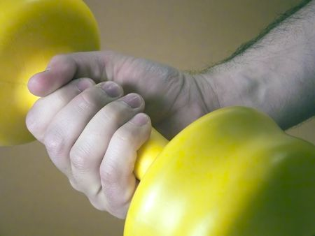 sweats: Hand holding weights