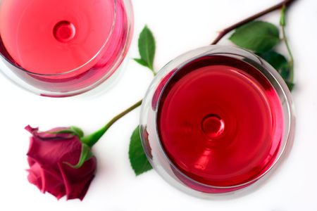 Two wine glasses and a red rose photo
