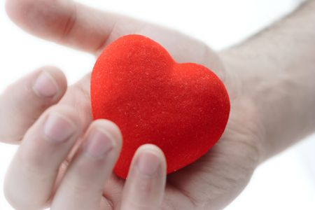 with fondness: Man holding a heart