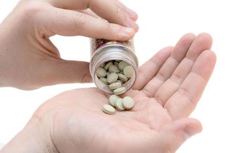 dispense: Hand holding pills