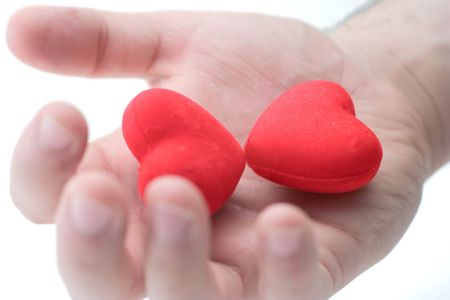 Man holding two hearts photo