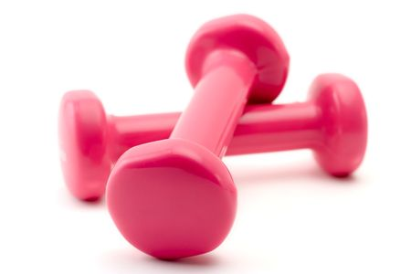 Pink dumbbells against white background Stock Photo