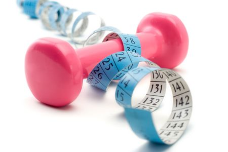 Women's weights wrapped around a measurement tape