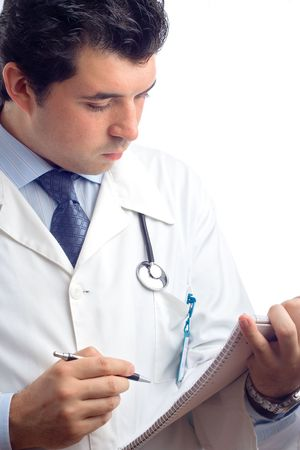 general knowledge: Physician writing down notes in a notebook