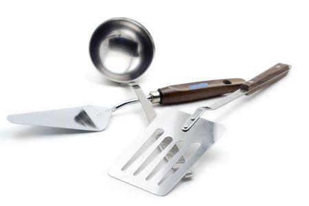 Kitchen utensil against white background photo