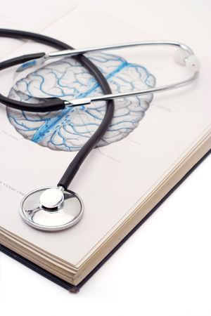 Stethoscope on a medical book photo