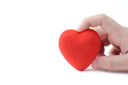 Person holding a heart against white background photo