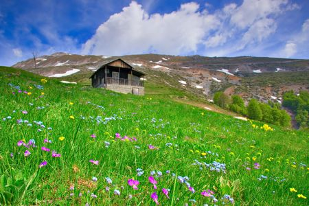 Cabin up in the mountains and a meadow in Macedonia Stock Photo - 491835