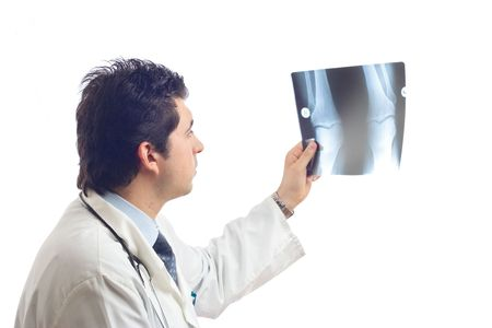 Doctor examining x-ray scans against white background Stock Photo - 491833