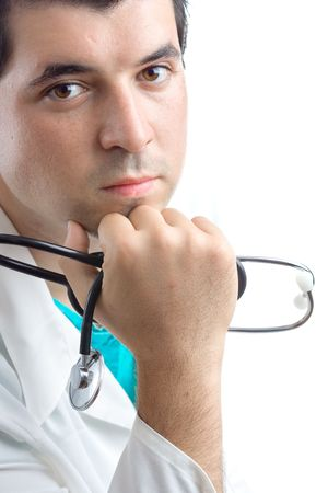 Male doctor holding a stethoscope in his hand against white background Stock Photo - 550053