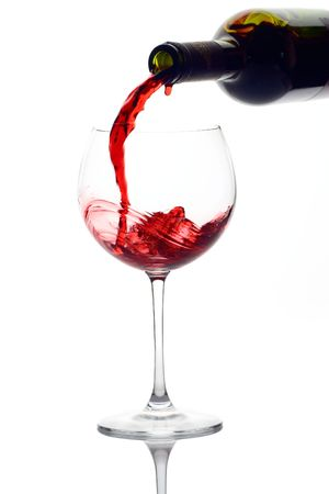 wineglass: Red wine pouring down from a wine bottle