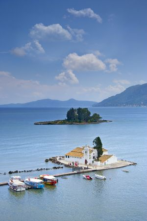 sea seaport: A view of a church and mouse island on Corfu, Greece