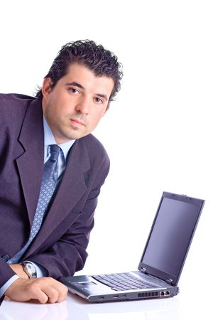 Satisfied young businessman with a lap top computer against white background photo
