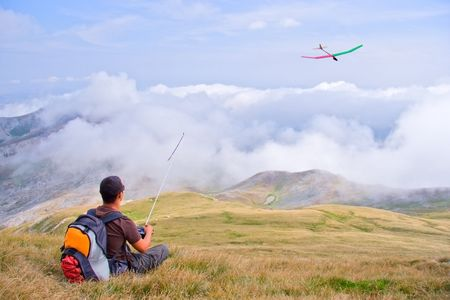 Man flying a plane from a top of the mountain Korab, Macedonia photo