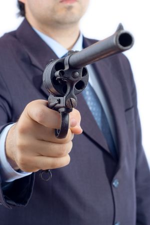 Person holding a gun against white background Stock Photo - 563805