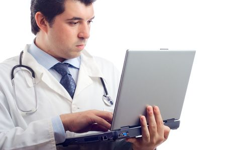 Hospital doctor working on a laptop computer Stock Photo