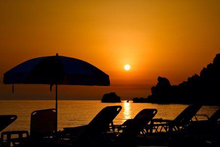 Sunset at the beach on Corfu island, Greece photo