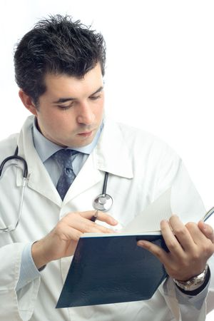 general knowledge: Young physician writing down notes in a notebook against white background