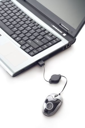 Laptop computer and a mouse against white background Stock Photo - 595137