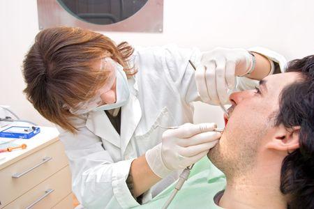 white glove test: At the dentist�s Stock Photo