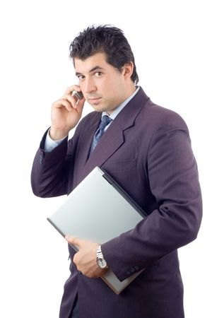 Businessman with a laptop computer talking on a cell phone photo