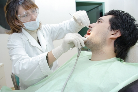 Dentist examining a patient photo