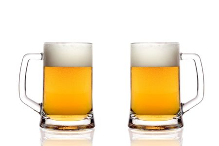 Beer glasses against white background photo