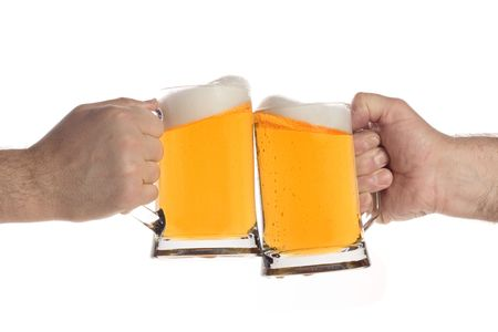beer mugs: Two people making a toast with beer mugs