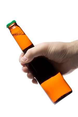 Hand holding  a beer against white background photo