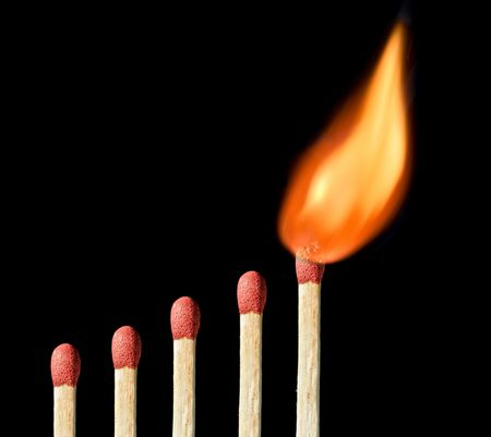 Matchstick pattern with one matchstick on fire photo