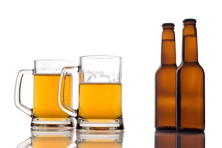 Beer mugs and two bottles of beer photo