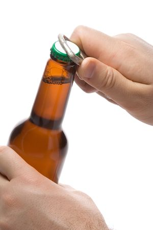 Person opening a bottle of beer photo