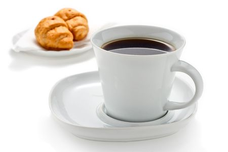 Coffee and croissants against white background Stock Photo