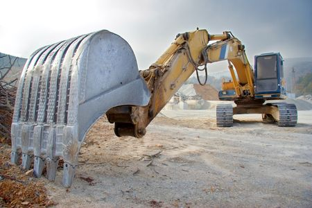 dredging tools: A view of a big bulldozer at construction site Stock Photo