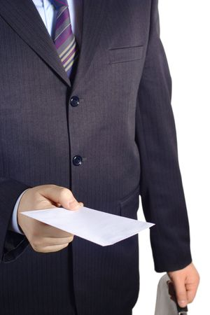 Businessman handing over a blank letter against white background photo