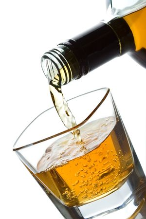 double glass: Double whiskey being poured into a glass