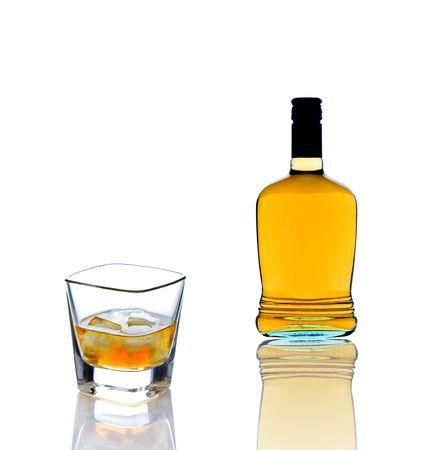 Whiskey bottle and a whiskey glass Stock Photo