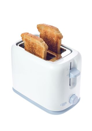 Toaster with two slices of bread against white background