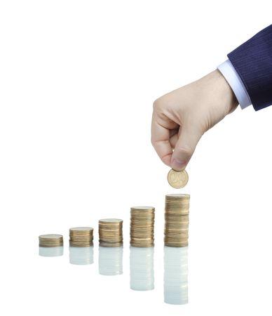 payout: Columnas de monedas contra el fondo blanco  Foto de archivo