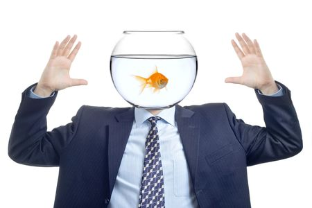 mockery: Man with a water bowl with golden fish instead of a head Stock Photo