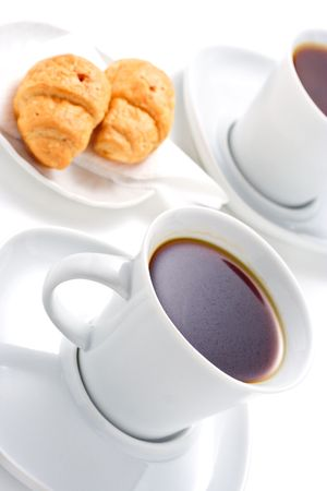Coffee and croissants against white background photo