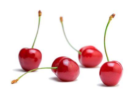 crimson colour: Cherries against white background Stock Photo