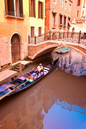 Gondolier in Venice, Italy photo