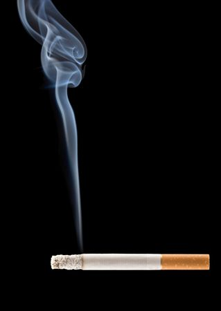 Cigarette smoke coming from a burning cigarette photo