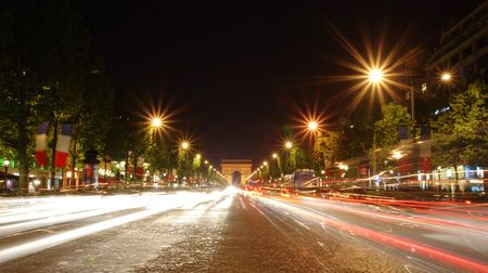 triumphal: Champs-Elysees avenue at night with the Triumphal Arch in the background
