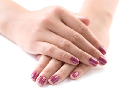 manicured: Manicured female hands isolated against white background